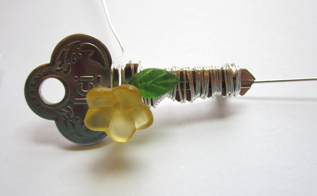adding flower bead to key brooch