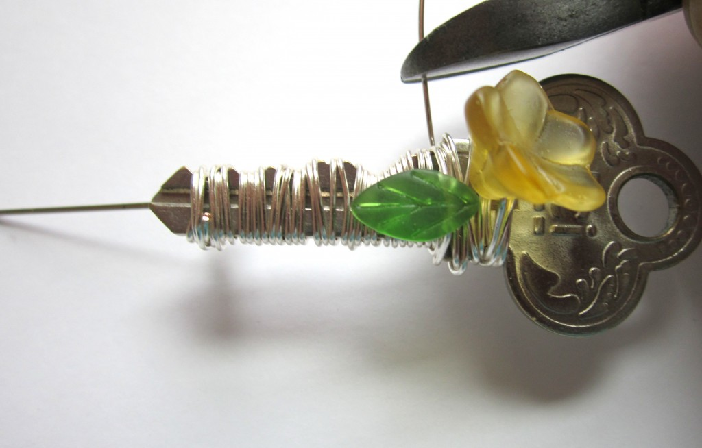 cut excess wire on key brooch
