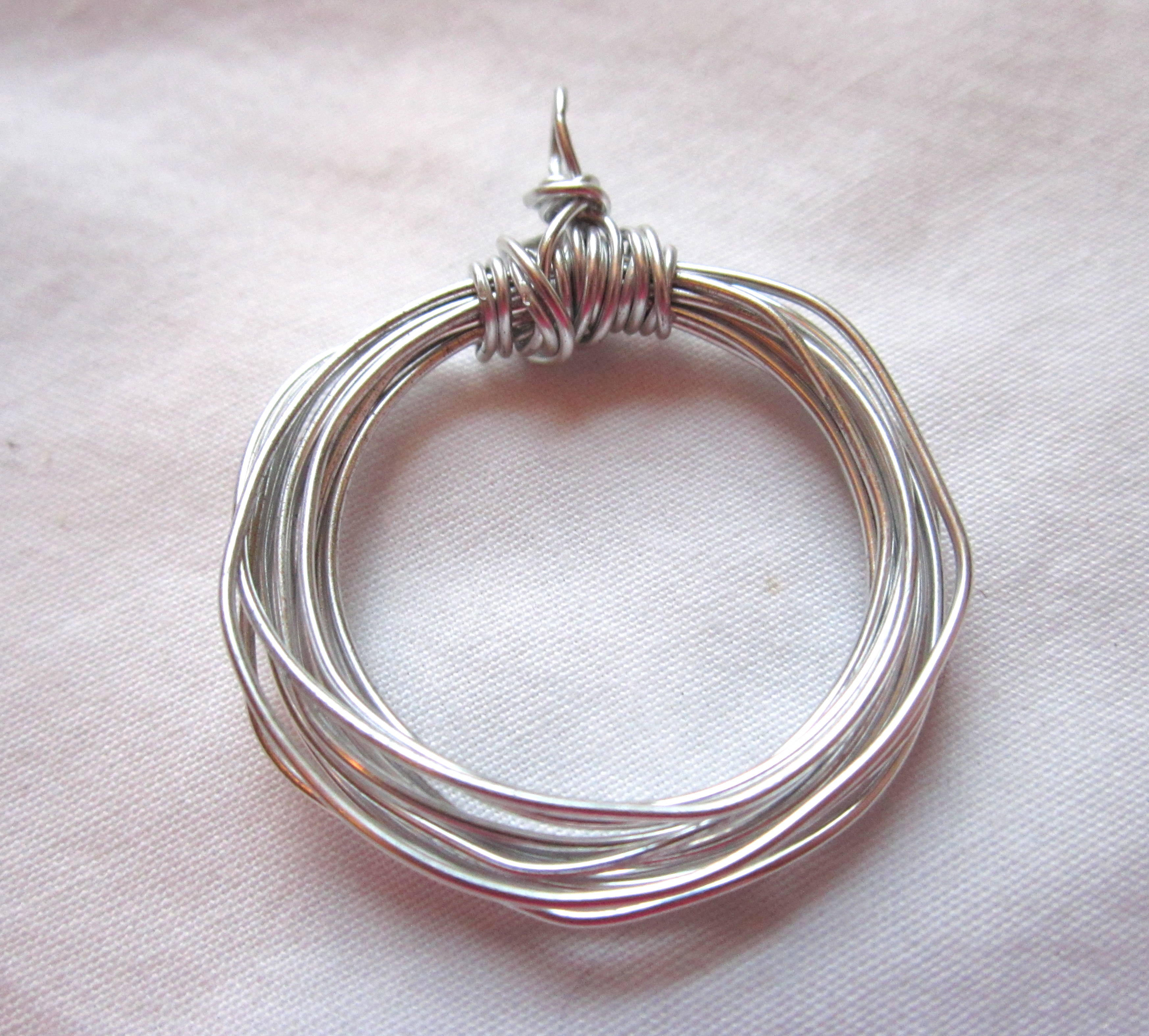 Ect tv episode 29 wire circle pendant video wire wrapping tutorial wire wrapped pendant tutorial 12 mozeypictures Image collections